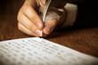 writer writes a fountain pen on paper work - 70731505