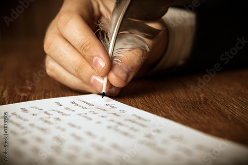 writer writes a fountain pen on paper work - 70731505