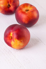 Three tasty fresh ripe juicy nectarines