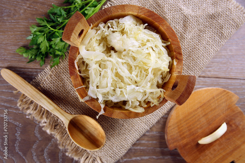 Sauerkraut in a wooden barrel - 70733756