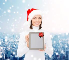 woman in santa helper hat with tablet pc
