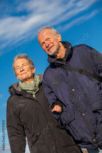Leinwanddruck Bild happy mature couple relaxing baltic sea dunes