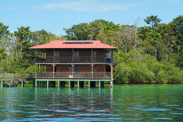 Off grid Caribbean house over water solar powered