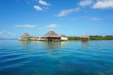 Tropical resort overwater with thatched roofs