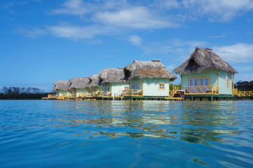 Tropical resort with thatched overwater bungalow