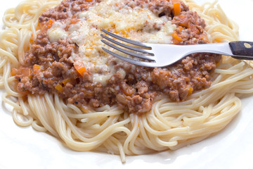 Spaghetti bolognese on plate with fork