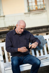 Man checking a photo on his mobile phone