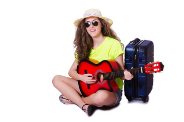 Travelling guitar player isolated on white