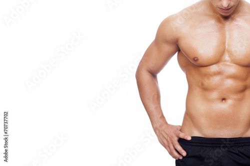 Fit young man with beautiful torso, isolated on white background - 70737702