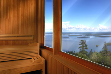 Luxury wooden sauna with a lake view