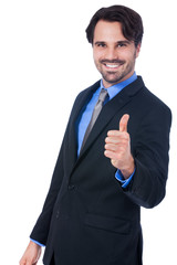 Enthusiastic businessman giving a thumbs up
