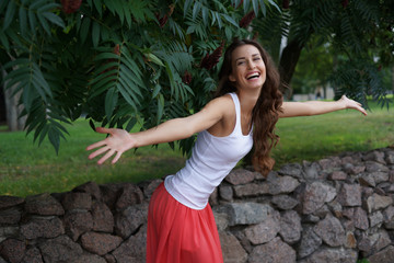attractive smile woman raised hands at you