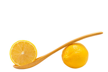 Lemons Fruit and wooden spoon ,isolated on white
