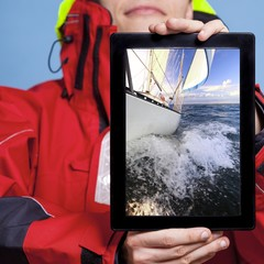 Man sailor showing yacht boat on tablet. Sailing