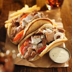 greek gyros with tzatkiki sauce, cola and fries