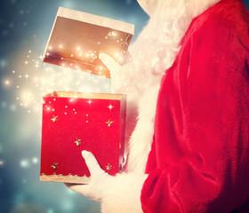 Santa Claus Opening a big Christmas Gift