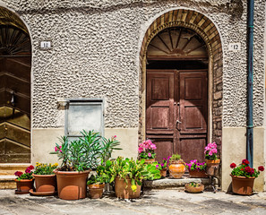 Windows and doors in an old house decorated with flower