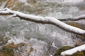 Icicles Above a Rushing Stream