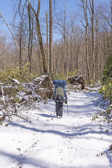 Backpacker on a Snowy Trail after a Spring Snow