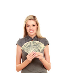 Young woman with dollars in her hands, isolated on white