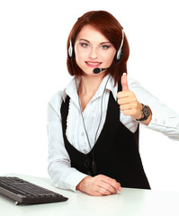 Smiling young customer service girl with a headset at her
