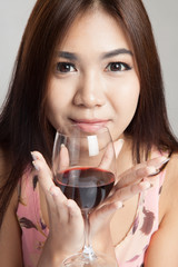 Beautiful Asian woman hold glass of  red wine