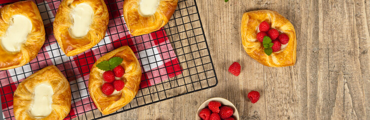 Raspberry pastries. Panoramic image. Selective focus.