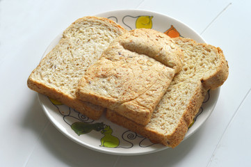 three fresh whole wheat bread slices