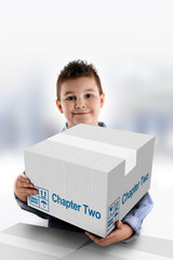 Boy holding a cardboard box on which was written Chapter Two