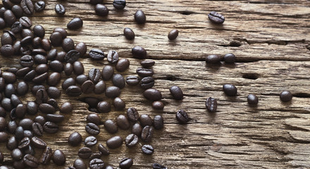 Coffee beans on old wooden background