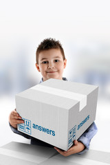 Boy holding a cardboard box on which was written Answers