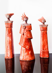 Three red african female figurines