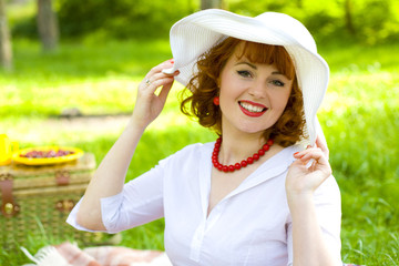 Beautiful stylish young lady in white hat