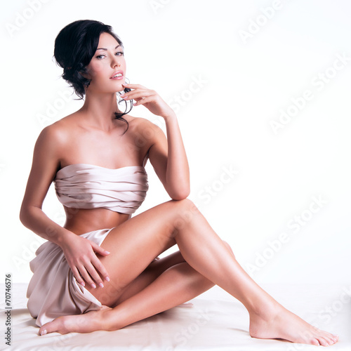 canvas print picture Sensual young woman with beautiful body in the beige silk