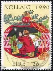 stamp printed in Ireland shows Child praying