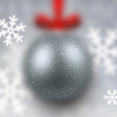Defocused silver christmas ball.