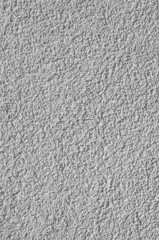 gray, relief plaster on wall closeup