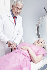 Male doctor reassuring female patient before computed tomography