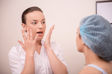 Portrait of a young woman with fresh and clean skin talking to h