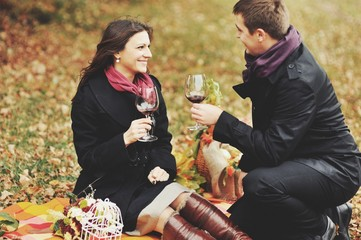 Young couple having date in autumn park.