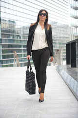 ADULT FASHION WOMAN WALKING