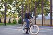 Businessman on his retro bike. Outdoor fashion portrait