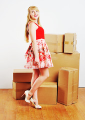 Young blond woman resting from moving into a new home.