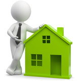 Makler mit grünem Haus