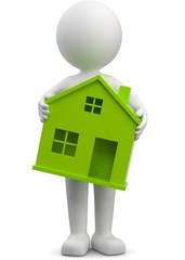 Männchen trägt grünes Haus Symbol