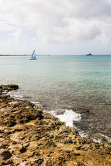 Surf On Rocks with Sailboat