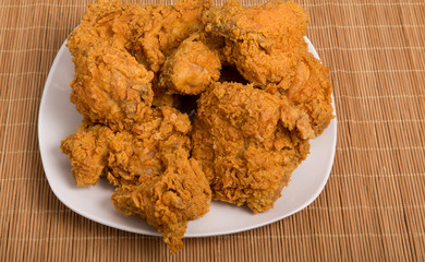 White Plate of Fried Chicken on Bamboo Placemat