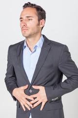 Geschäftsmann leidet unter Bauchchmerz