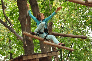 girl  in a climbing adventure activity park
