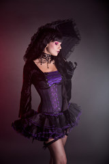 Gothic girl in purple Victorian outfit